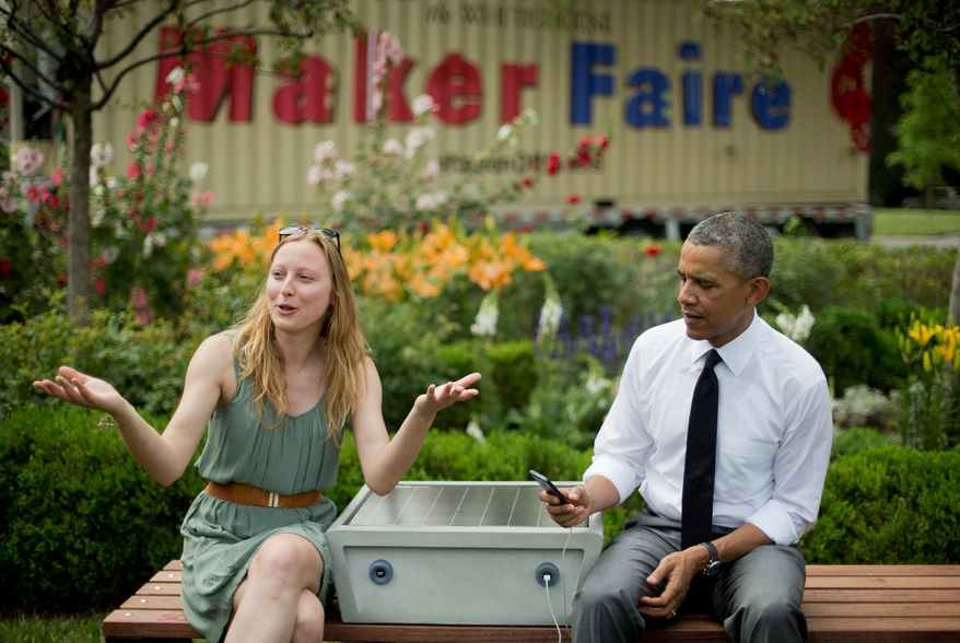 Sandra Richter, who helped design a bench that allows people to charge their phones, sits with President Obama during his meeting with entrepreneurs and inventors at White House on Wednesday during the Maker Faire. (Associated Press)