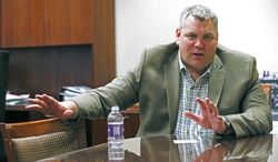 In this May 12, 2014 photograph, Scott Barber, Caesars regional president for the Mid-South, discusses the closing of Harrah's Tunica casino, in his office at the Robinsonville, Miss., gaming facility. The closure affects a work force of about 1,300 and involves several hotels, a golf course, a convention center and the casino itself. Caesars Entertainment Corp., will continue to operate its two other area properties: Horseshoe Tunica and Tunica Roadhouse Hotel and Casino. (AP Photo/Rogelio V. Solis)