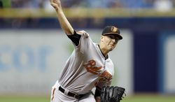 Baltimore Orioles starting pitcher Kevin Gausman delivers to the Tampa Bay Rays during the first inning of a baseball game Wednesday, June 18, 2014, in St. Petersburg, Fla. (AP Photo/Chris O'Meara)