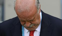 Spain's head coach Vicente Del Bosque looks down before the start of the group B World Cup soccer match between Spain and Chile at the Maracana Stadium in Rio de Janeiro, Brazil, Wednesday, June 18, 2014. (AP Photo/Manu Fernandez)