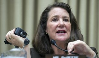 The House Oversight and Investigations subcommittee ranking member, Rep. Diana DeGette, D-Colo., holds an automobile ignition switch as she addresses General Motors CEO Mary Barra and others as they testify on Capitol Hill in Washington, Wednesday, June 18, 2014. (AP Photo/Cliff Owen) ** FILE **