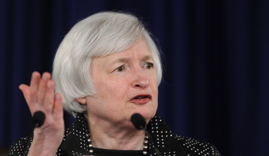 Federal Reserve Chair Janet Yellen speaks during a news conference at the Federal Reserve in Washington, Wednesday, June 18, 2014. The Federal Reserve has sharply cut its forecast for U.S. growth this year, reflecting a shrinking economy last quarter caused mostly by harsh weather. (AP Photo/Susan Walsh)