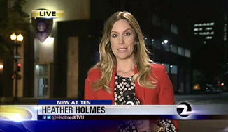 KTVU reporter Heather Holmes had her purse stolen just a few feet away from her during a live report outside of the police headquarters in Oakland, Calif. (KTVU)