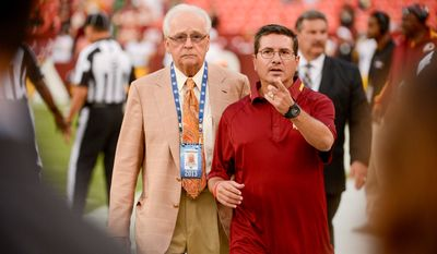 Dr. James Andrews, left, and Washington Redskins owner Dan Snyder, right, talk together before the Washington Redskins play the Pittsburgh Steelers in NFL preseason football at FedEx Field, Landover, Md., Monday, August 19, 2013. (Andrew Harnik/The Washington Times)