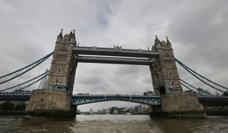 A view of Tower Bridge over the river Thames in London, Thursday, June 19, 2014. London  has never been graced with the elegant arches of Venice or Paris. A new exhibition at Museum of London Docklands wants visitors to look again, peering on, under and even inside the structures spanning the River Thames.   (AP Photo/Lefteris Pitarakis)