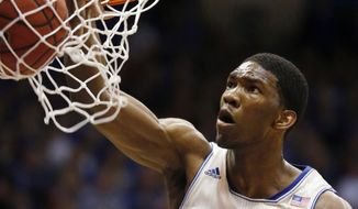 Kansas center Joel Embiid dunks during the first half of an NCAA college basketball game against Texas in Lawrence, Kan., Saturday, Feb. 22, 2014. (AP Photo/Orlin Wagner)