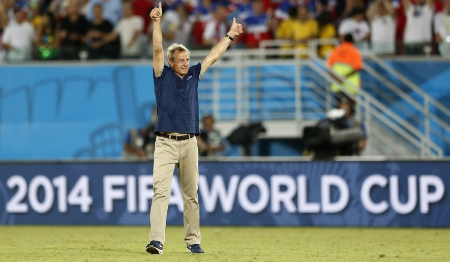 United States' head coach Juergen Klinsmann celebrates after his team's 2-1 victory over Ghana during the group G World Cup soccer match between Ghana and the United States at the Arena das Dunas in Natal, Brazil, Monday, June 16, 2014. (AP Photo/Julio Cortez)