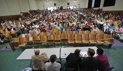 Town residents listen during a presentation by federal officials involved in the placement of immigrant children at St Paul's College in Lawrenceville, Va., Thursday, June 19, 2014. The program is on hold pending comments from local residents (AP Photo/Steve Helber)