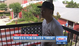 "Duy Tran says the manager of his Houston-area apartment complex told him to remove the American flag hanging outside his home, because she deemed it a ""threat to the Muslim community."" (KHOU 11 News)"