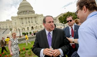 Former Arkansas Gov. Mike Huckabee greets rally attendees after speaking at a rally on the West Lawn of the U.S. Capitol Building before marching to the U.S. Supreme Court for the second annual March for Marriage, Washington, D.C., Thursday, June 19, 2014. The group is returning to the supreme court for a second year in a row after their first march last year on the day the Court heard oral arguments in the case Hollingsorth v. Perry that argued the legality of California's Proposition 8. (Andrew Harnik/The Washington Times)