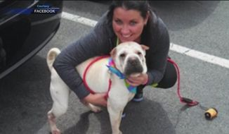 Sarah Gossard with her beloved shar-pei, Nala. A Baltimore police officer was arrested and charged with aggravated animal cruelty after he slit Nala's throat, authorities said Wednesday. (WBAL-TV/Facebook)