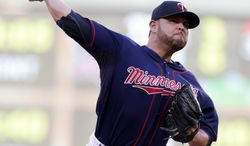 Minnesota Twins pitcher Ricky Nolasco throws against the Chicago White Sox in the first inning of a baseball game on Friday, June 20, 2014, in Minneapolis. (AP Photo/Jim Mone)
