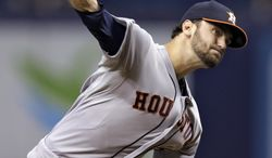 Houston Astros starting pitcher Jarred Cosart delivers to the Tampa Bay Rays during the first inning of a baseball game Friday, June 20, 2014, in St. Petersburg, Fla. (AP Photo/Chris O'Meara)