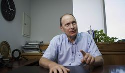 """Israeli Medical Association president Dr. Leonid Eidelman speaks during an interview with The Associated Press at his office in Ramat Gan, Israel, Thursday, June 19, 2014. Dr. Eidelman says in an interview that doctors """"will absolutely refuse to cooperate'' if parliament passes legislation permitting the force-feeding of prisoners on hunger strike. (AP Photo/Dan Balilty)"""