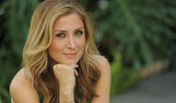 """In this Wednesday, June 18, 2014 photo, actress Sasha Alexander poses for a portrait in Los Angeles. Season five of Alexander's crime drama """"Rizzoli and Isles"""" premiered Tuesday, June 17, 2014, on TNT. The episode was the first to address the death of actor Lee Thompson Young. (Photo by Chris Pizzello/Invision/AP)"""
