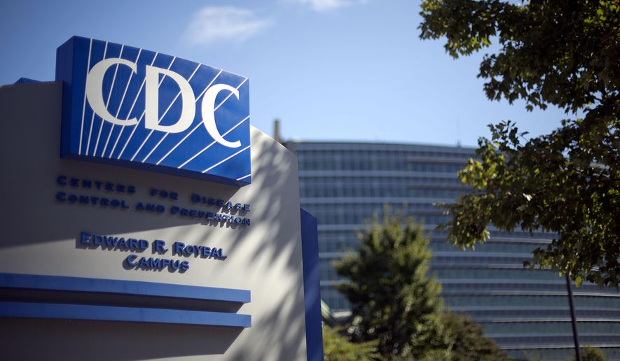 FILE - In this Oct. 8, 2013, file photo, a sign marks the entrance to the federal Centers for Disease Control and Prevention,in Atlanta. The CDC said Thursday, June 19, 2014, that some of its staff in Atlanta may have been accidentally exposed to dangerous anthrax bacteria because of a safety problem at some of its labs. (AP Photo/David Goldman, File)