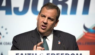 New Jersey Gov. Chris Christie speaks at the Faith and Freedom Coalition's Road to Majority event in Washington, Friday, June 20, 2014. Christie joined the parade of ambitious Republicans courting religious conservatives as the early jockeying for the next presidential contest intensifies.  (AP Photo/Molly Riley)