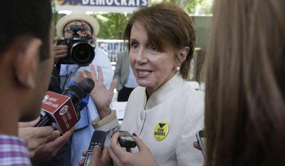 House Minority Leader Nancy Pelosi talks with reporters after attending the opening of the new California Democratic Party headquarters in Sacramento, Calif., Monday, June 16, 2014. (AP Photo/Rich Pedroncelli)