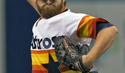 Houston Astros starter Jake Buchanan pitches against the Tampa Bay Rays in the first inning of a baseball game Saturday, June 21, 2014 in St. Petersburg, Fla. (AP Photo/Steve Nesius)