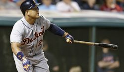 Detroit Tigers' Miguel Cabrera watches his RBI double off Cleveland Indians relief pitcher Cody Allen in the 10th inning of a baseball game, Saturday, June 21, 2014, in Cleveland. Ian Kinsler scored on the play. (AP Photo/Tony Dejak)