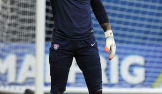 United States' Tim Howard gestures during a training session at the Arena da Amazonia in Manaus, Brazil, Sunday, June 22, 2014. The U.S. will play Portugal in group G of the 2014 soccer World Cup on June 22. (AP Photo/Paulo Duarte)