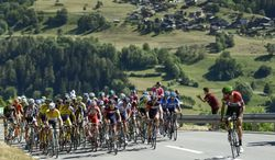 The pack  cycles during the 8.  stage, a 219.1 km race, from Delemont to Verbier, at the 78. Tour de Suisse UCI ProTour cycling race, in Verbier, Switzerland, Saturday, June 21, 2014. (AP Photo/Keystone,Jean-Christophe Bott)
