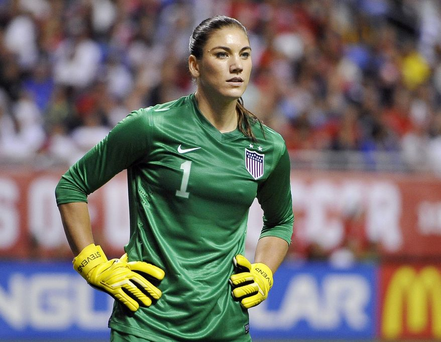 FILE - In this Oct. 20, 2013, file photo, United States goalkeeper Hope Solo pauses on the field during the second half of an international friendly women's soccer match against Australia in San Antonio. Police say Solo has been arrested early Saturday, June 21, 2014, at a suburban Seattle home for assaulting her sister and nephew. (AP Photo/Darren Abate, File)