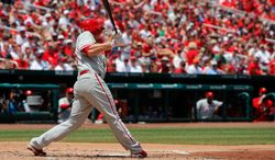 Philadelphia Phillies' Cody Asche hits a three-run double during the second inning of a baseball game against the St. Louis Cardinals, Sunday, June 22, 2014, in St. Louis. (AP Photo/Scott Kane)