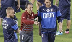 Italy head coach Cesare Prandelli, center, instructs goalkeeper Gianluigi Buffon, right, and midfielder Daniele De Rossi during a training session of the Italian national soccer team in Natal, Brazil, Saturday, June 21, 2014. Italy proved ineffective in a 1-0 loss to Costa Rica on Friday and now the Azzurri need a win or a draw against Uruguay on Tuesday to reach the second round of the World Cup. (AP Photo/Antonio Calanni)