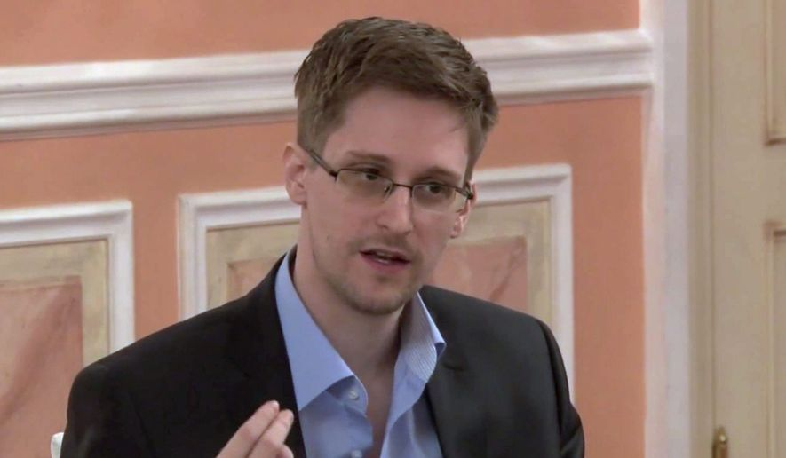 In this image made from video released by WikiLeaks on Friday, Oct. 11, 2013, former National Security Agency systems analyst Edward Snowden speaks during a presentation ceremony for the Sam Adams Award in Moscow, Russia. (AP Photo) ** FILE **
