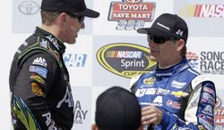 Carl Edwards, left is congratulated by Jeff Gordon, right, after winning the NASCAR Sprint Cup Series auto race Sunday, June 22, 2014, in Sonoma, Calif. Edwards won the race and Gordon finished second. (AP Photo/Eric Risberg)