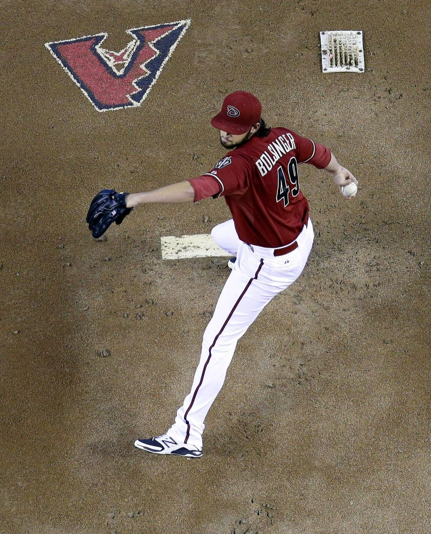 Arizona Diamondbacks pitcher Michael Bolsinger throws against the San Francisco Giants during the first inning of a baseball game on Sunday, June 22, 2014, in Phoenix. (AP Photo/Matt York)
