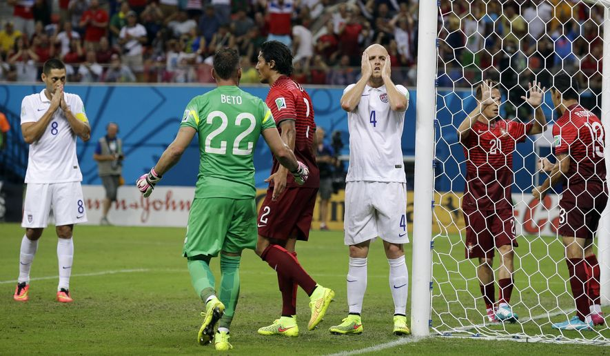 United States' Michael Bradley (4) reacts after his shot on an open goal was blocked by Portugal's Ricardo Costa (13) during the group G World Cup soccer match between the USA and Portugal at the Arena da Amazonia in Manaus, Brazil, Sunday, June 22, 2014. (AP Photo/Martin Mejia)