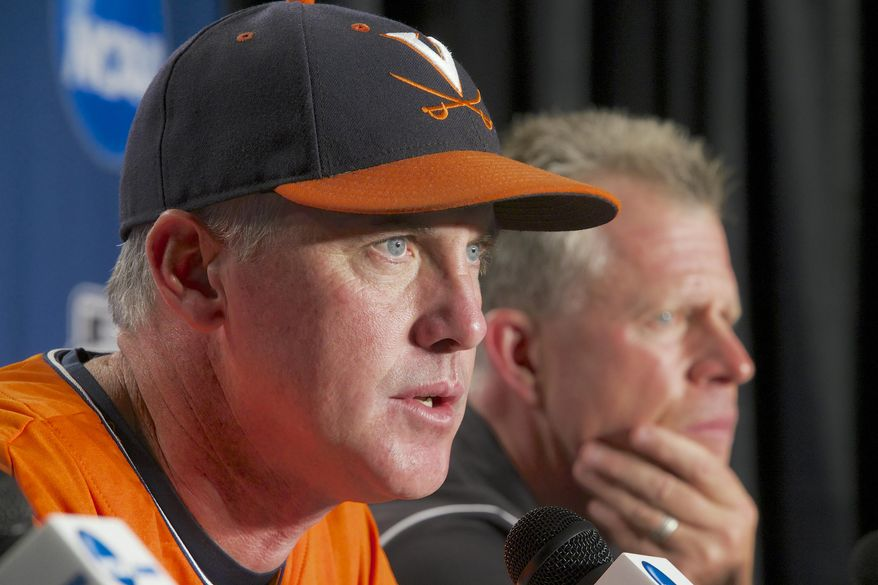 Virginia coach Brian O'Connor speaks at a news conference, Sunday, June 22, 2014, with Vanderbilt coach Tim Corbin, right, listening before the NCAA baseball College World Series finals between the teams which begin on Monday at TD Ameritrade Park in Omaha, Neb. (AP Photo/Nati Harnik)