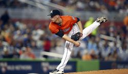 Miami Marlins' Anthony DeSciafani pitches to the New York Mets during the second inning of a baseball game in Miami, Sunday, June 22, 2014.  (AP Photo/J Pat Carter)