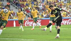 Spain's David Villa fires wide with a shot during the group B World Cup soccer match between Australia and Spain at the Arena da Baixada in Curitiba, Brazil, Monday, June 23, 2014. (AP Photo/Martin Meissner)