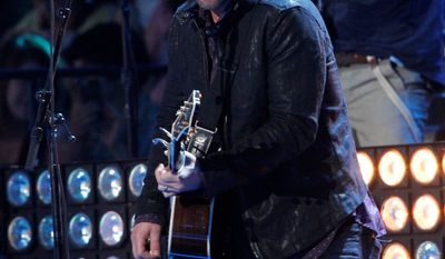 "Country artist David Nail's chart topper ""Whatever She's Got"" from his March release 'I'm a Fire"" has a distinctive acoustic country vibe. ""Whatever She's Got"" reminds listeners of Glen Campbell's (top right) ""Rhinestone Cowboy."" (associated press photographs)"