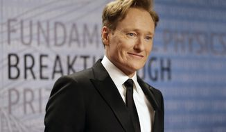FILE - In this Dec. 12, 2013, file photo, talk show host Conan O'Brien arrives for the Breakthrough Prize in Life Sciences awards in Moffett Field, Calif. A home owned by O'Brien has been removed from a Rhode Island auction after he paid some back taxes on the property. Town officials tell the Westerly Sun that O'Brien paid his $8,000 bill on Friday, June 20, 2014. (AP Photo/Ben Margot, File)