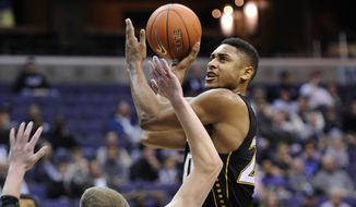 Towson forward Jerrelle Benimon, right, is fouled by Georgetown forward Nate Lubick (34) during the first half of an NCAA college basketball game, Saturday, Dec. 8, 2012, in Washington. (AP Photo/Nick Wass)