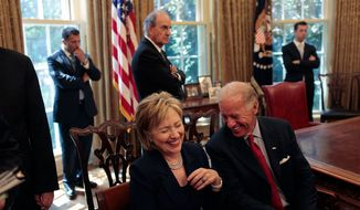 Former Secretary of State Hillary Rodham Clinton laughs at a remark by Vice President Joe Biden as they wait for the start of a press statement by President Barack Obama and Egyptian President Hosni Mubarak in the Oval Office Aug. 18, 2009. (Official White House Photo by Lawrence Jackson) ** FILE **