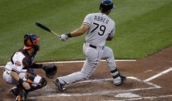Chicago White Sox's Jose Abreu hits a sacrifice ground ball in the third inning of a baseball game against the Baltimore Orioles, Monday, June 23, 2014, in Baltimore. Adam Eaton scored on the play. (AP Photo/Patrick Semansky)