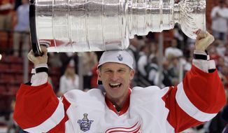 FILE - In this June 4, 2008 file photo, Detroit Red Wings goalie Dominik Hasek, of the Czech Republic, holds the Stanley Cup after the Red Wings defeated the Pittsburgh Penguins in Game 6 of the Stanley Cup hockey finals in Pittsburgh. Hasek is expected to be part of the class of 2014 at the Hockey Hall of Fame, which will be announced Monday, June 23, 2014. (AP Photo/Gene J. Puskar, File)