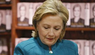 """Former Secretary of State Hillary Rodham Clinton signs copies of her new book """"Hard Choices,"""" her recounting of her time as President Barack Obama's top diplomat, at a book signing event at the Tattered Cover Book store in Denver on Monday, June 23, 2014. (AP Photo/Ed Andrieski)"""
