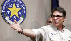 """Texas Gov. Rick Perry talks to the media after touring the McAllen Border Patrol station, Monday June 23, 2014, at the Texas Department of Public Safety regional headquarters in Weslaco, Texas. Perry said the number of immigrants being arrested has created an """"untenable situation."""" (AP Photo/The Monitor, Gabe Hernandez)"""