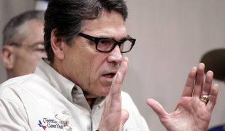 "Texas Gov. Rick Perry talks to the media Monday, June 23, 2014, in Weslaco, Texas, after touring the McAllen Border Patrol station. Perry said that the border is not secure, adding, ""This is an absolute humanitarian catastrophe waiting to happen."" (AP Photo/The Monitor, Gabe Hernandez)"
