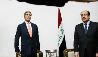 U.S. Secretary of State John Kerry, left, meets with Iraqi Prime Minister Nouri al-Maliki in Baghdad, Iraq, Monday, June 23, 2014. Kerry flew to Baghdad on Monday to meet with Iraq's leaders and personally urge the Shiite-led government to give more power to political opponents before a Sunni insurgency seizes more control across the country and sweeps away hopes for lasting peace. (AP Photo/Brendan Smialowski, Pool)