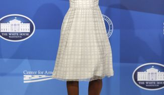 First lady Michelle Obama arrives to speak at The White House Summit on Working Families at a hotel in Washington, Monday, June 23, 2014. The gathering, organized by the White House, Department of Labor, and the Center for American Progress, highlights the challenges and offers solutions faced by working families in America. (AP Photo/Charles Dharapak)
