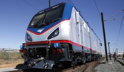 FILE - This May 13, 2013 file photo shows an Amtrak Cities Sprinter Locomotive in Sacramento, Calif.  The Supreme Court will consider whether Amtrak can partner with a government agency to create rules that other private railroads must follow. The justices agreed Monday to hear the Obama administration's appeal of a lower court ruling that said Congress unconstitutionally gave regulatory power to the passenger railroad company. (AP Photo/Rich Pedroncelli, File)
