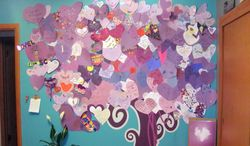 This June 19, 2014 photo provided by Dana Hoffmann shows a tree with a canopy of heart-shaped cards sent from people from around the world in the bedroom of a 12-year-old Waukesha, Wis., girl who was stabbed 19 times. Court documents indicate that two 12-year-old schoolmates stabbed the girl in a plan to curry favor with Slender Man, a character in horror stories they had read online. (AP Photo/Dana Hoffmann)