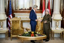 U.S. Secretary of State John Kerry, left, speaks with Kurdish regional President Massoud Barzani, ahead of a meeting in Irbil, Iraq, Tuesday, June 24, 2014. Kerry arrived in Iraq's Kurdish region in a US diplomatic drive aimed at preventing the country from splitting apart in the face of militants pushing towards Baghdad. (AP Photo/Brendan Smialowski, Pool)